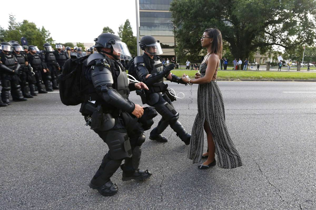 A demonstrator protesting the shooting death of Alton Sterling is detained by law enforcement near the headquarters of the Baton Rouge Police Department in Baton Rouge, Louisiana, U.S. July 9, 2016. Photo By Jonathan Bachman